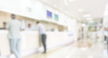 Medical blur background customer reception or patient service counter, office lobby in hospital clinic, or bank business building blurry interior inside waiting hall area
